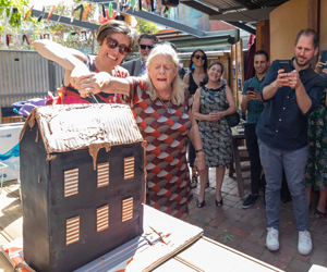 Co-CEOs Caitlin Dullard and Liz Jones cut the cake on the rebuild of La Mama Theatre.