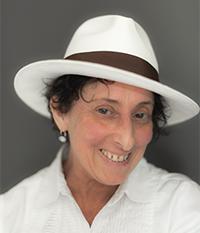 portrait image of author wearing white hat