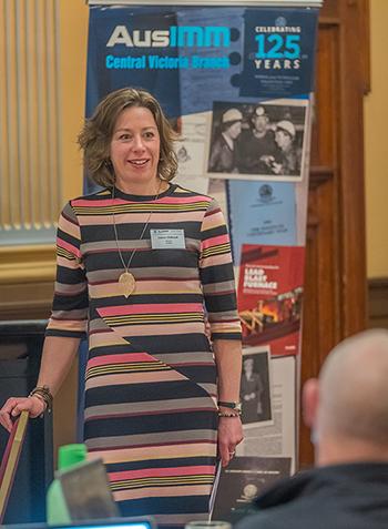 Laura presenting at a meeting